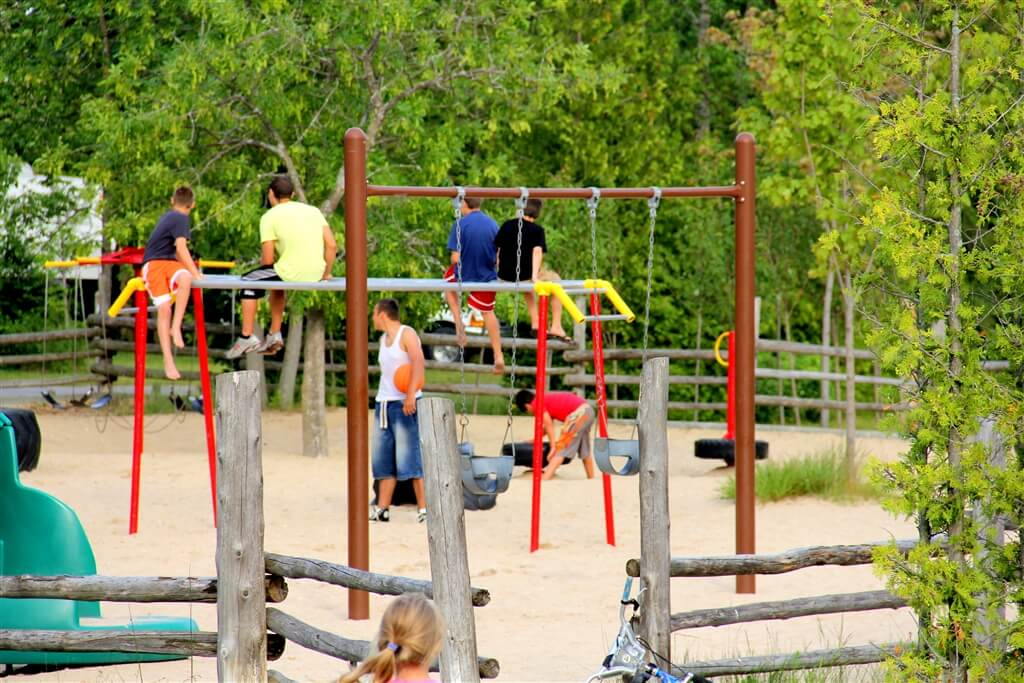 Photo of one of three playgrounds at Mackinaw Mill Creek Camping in Mackinaw City, MI. © 2016 Frank Rogala.