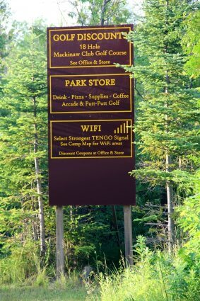 Photo of camp sign for discounted golf, the park store and Wi-Fi at Mackinaw Mill Creek Camping in Mackinaw City, MI. © 2016 Frank Rogala.