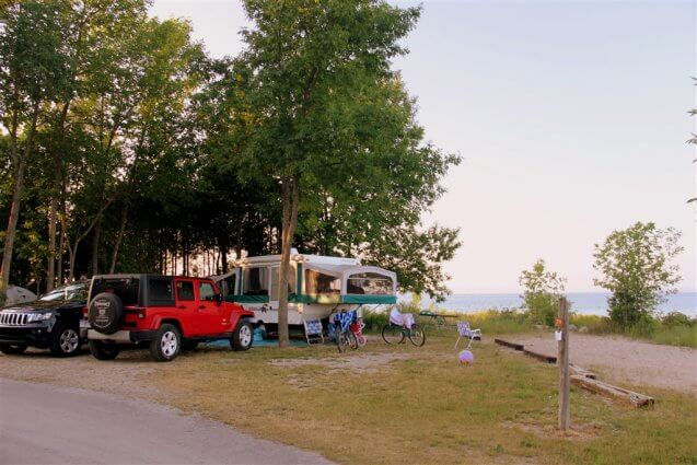 Photo of a popup trailer in a regular size campsite at Mackinaw Mill Creek Camping in Mackinaw City, MI. © 2016 Frank Rogala.