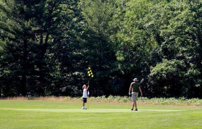 Photo of golfers on a green at the Mackinaw Club Golf Course in Carp Lake, MI. © 2016 Frank Rogala.