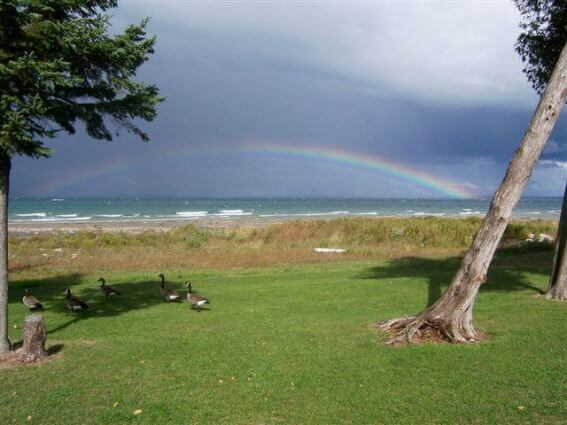 Photo of rainbow over Lake Huron by Linda Aukerman at Mackinaw Mill Creek Camping in Mackinaw City, MI.