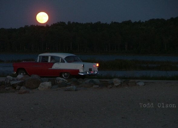 Photo of full moon over Chris Rogala's antique car by Todd Olson at Mackinaw Mill Creek Camping in Mackinaw City, MI.
