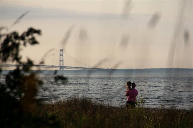 Photo of campers viewing the Mackinac Bridge from Mackinaw Mill Creek Camping ni Mackinaw City, MI. © 2016 Frank Rogala.