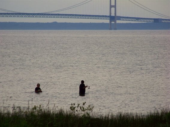 Photo of campers fishing from the shores of Mackinaw Mill Creek Camping in Mackinaw City, MI. © 2016 Frank Rogala.