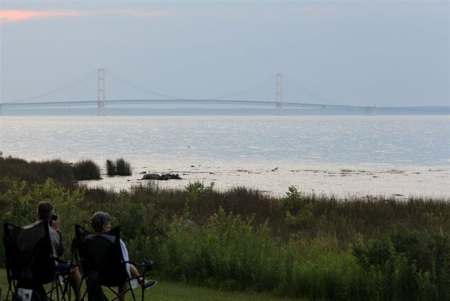 Photo of campers enjoying the view of the Mackinac Bridge during twilight at Mackinaw Mill Creek Camping in Mackinaw City, MI. © 2016 Frank Rogala.