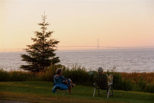 Photo of camper viewing the Mackinac Bridge from Mackinaw Mill Creek Camping in Mackinaw City, MI. © 2016 Frank Rogala.
