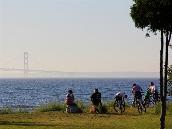 Photo of campers enjoying a view of the Mackinac Bridge from Mackinaw Mill Creek Camping in Mackinaw City, MI. © 2016 Frank Rogala.