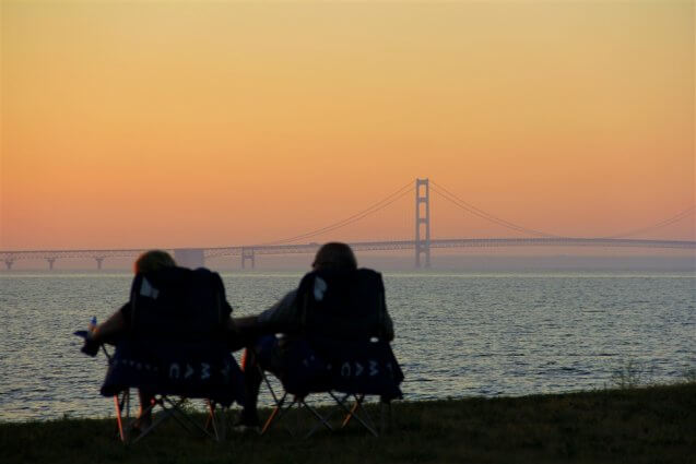 Photo of a couple watching the sunset over the Mackinac Bridge from Mackinaw Mill Creek Camping in Mackinaw City, MI. © 2016 Frank Rogala.