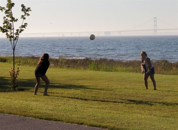 Photo of campers playing volleyball at Mackinaw Mill Creek Camping in Mackinaw City, MI. © 2016 Frank Rogala.