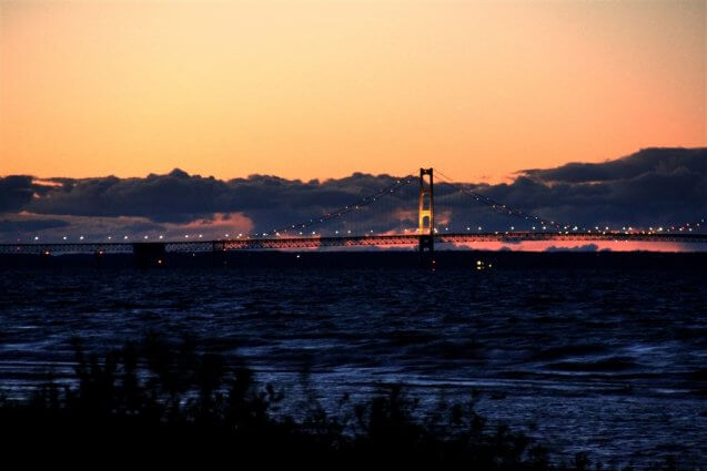 Photo of the Mackinac Bridge lit up at sunset from Mackinaw Mill Creek Camping in Mackinaw City, MI. © 2016 Frank Rogala.