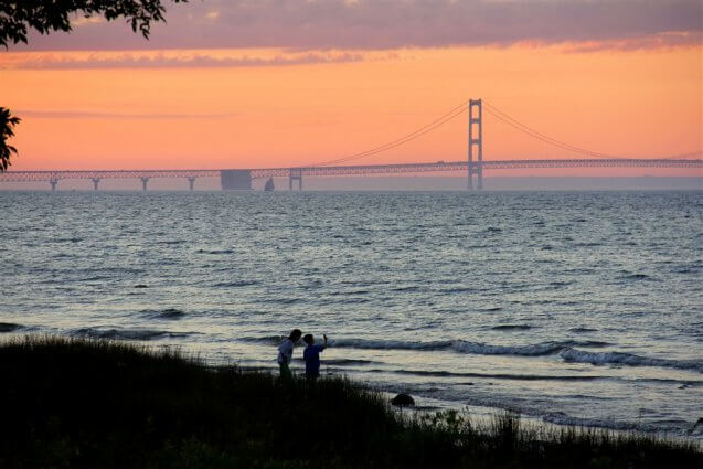 Photo of a schooner crossing in front of the Mackinac Bridge from the shore of Mackinaw Mill Creek Camping in Mackinaw City, MI. © 2016 Frank Rogala.