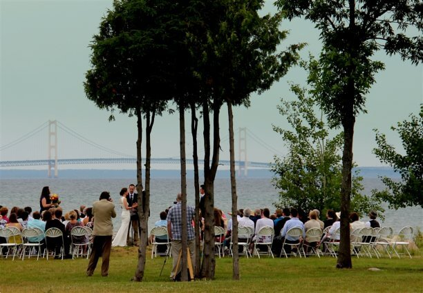 Photo of a wedding in progress at Mackinaw Mill Creek Camping in Mackinaw City, MI. © 2016 Frank Rogala.