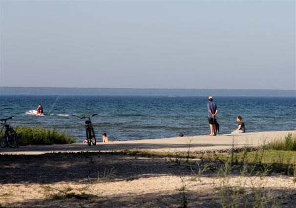 Photo of campers jet skiing near the boat launch at Mackinaw Mill Creek Camping in Mackinaw City, MI. © 2016 Frank Rogala.