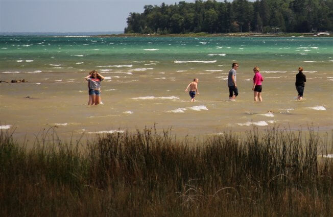 Photo of people wading at the natural beach at Mackinaw Mill Creek Camping in Mackinaw City, MI. © 2016 Frank Rogala.