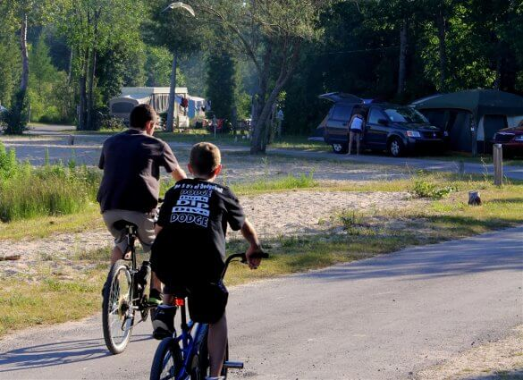 Photo of campers riding bikes at Mackinaw Mill Creek Camping in Mackinaw City, MI. © 2016 Frank Rogala.