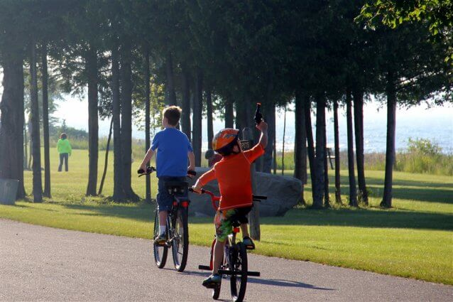 Photo of children riding their bikes at Mackinaw Mill Creek Camping in Mackinaw City, MI. © 2016 Frank Rogala.