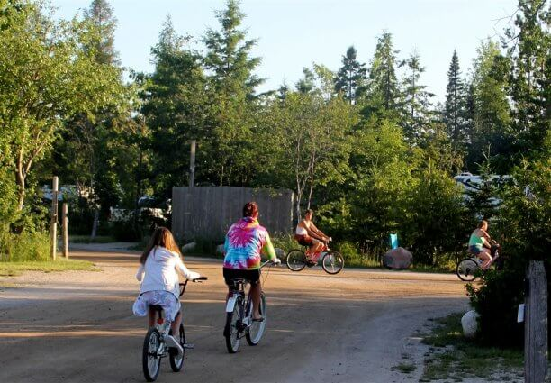 Photo of campers riding bikes near the large RV area at Mackinaw Mill Creek Camping in Mackinaw City, MI. © 2016 Frank Rogala.