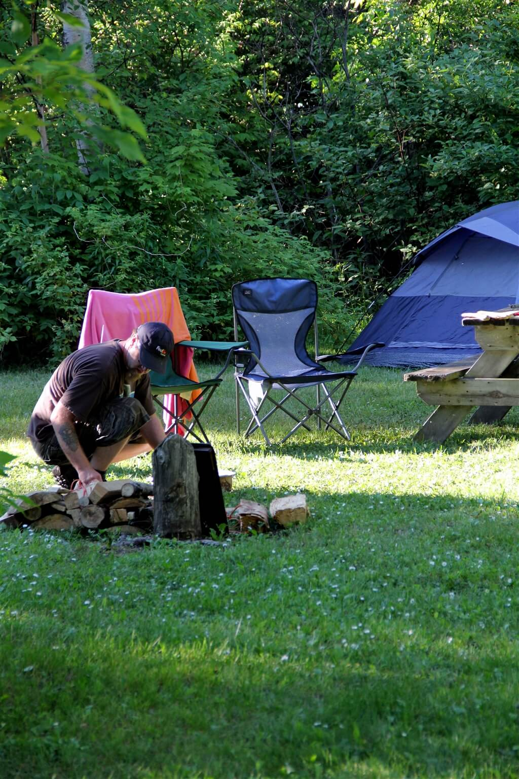 Photo of a camper building a campfire at Mackinaw Mill Creek Camping in Mackinaw City, MI. © 2016 Frank Rogala.