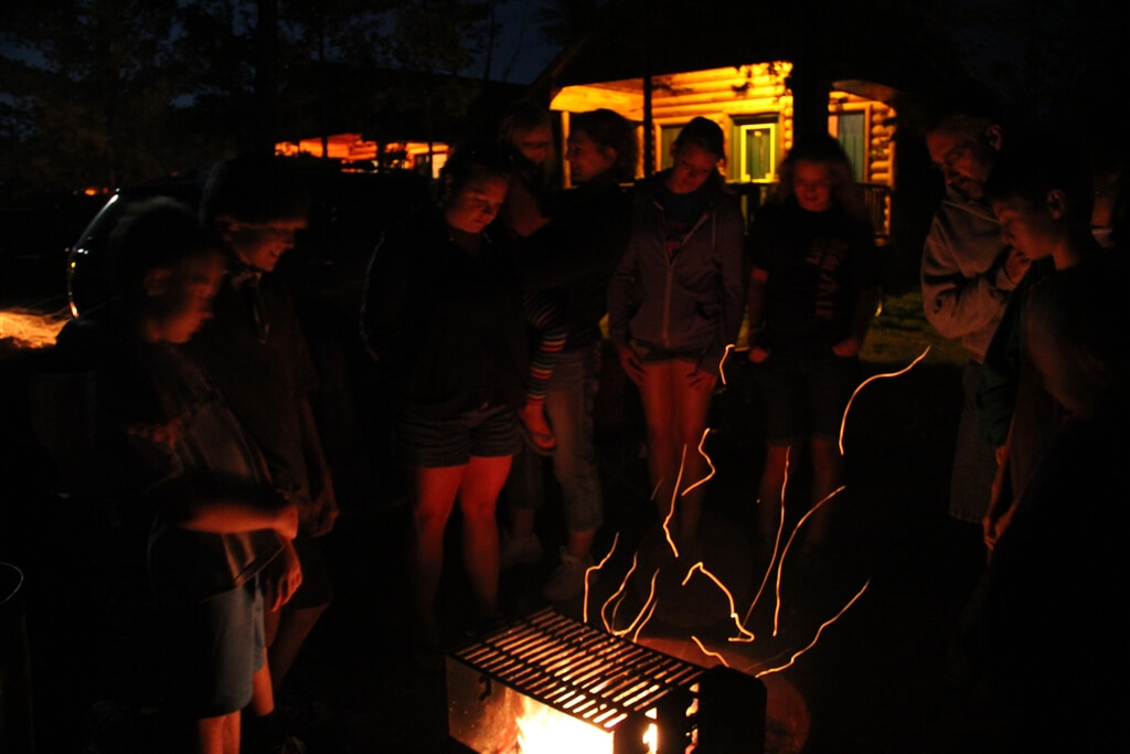 Photo of a campfire in a cabin fire ring at Mackinaw Mill Creek Camping in Mackinaw City, MI. © 2016 Frank Rogala.