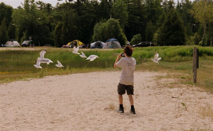 Photo of camper photographing the seagulls at Mackinaw Mill Creek Camping in Mackinaw City, MI. © 2016 Frank Rogala.