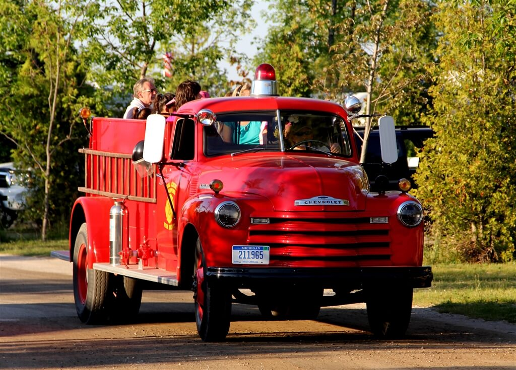Photo of a 1940s era fire truck, offering free rides at Mackinaw Mill Creek Camping in Mackinaw City, MI. © 2016 Frank Rogala.
