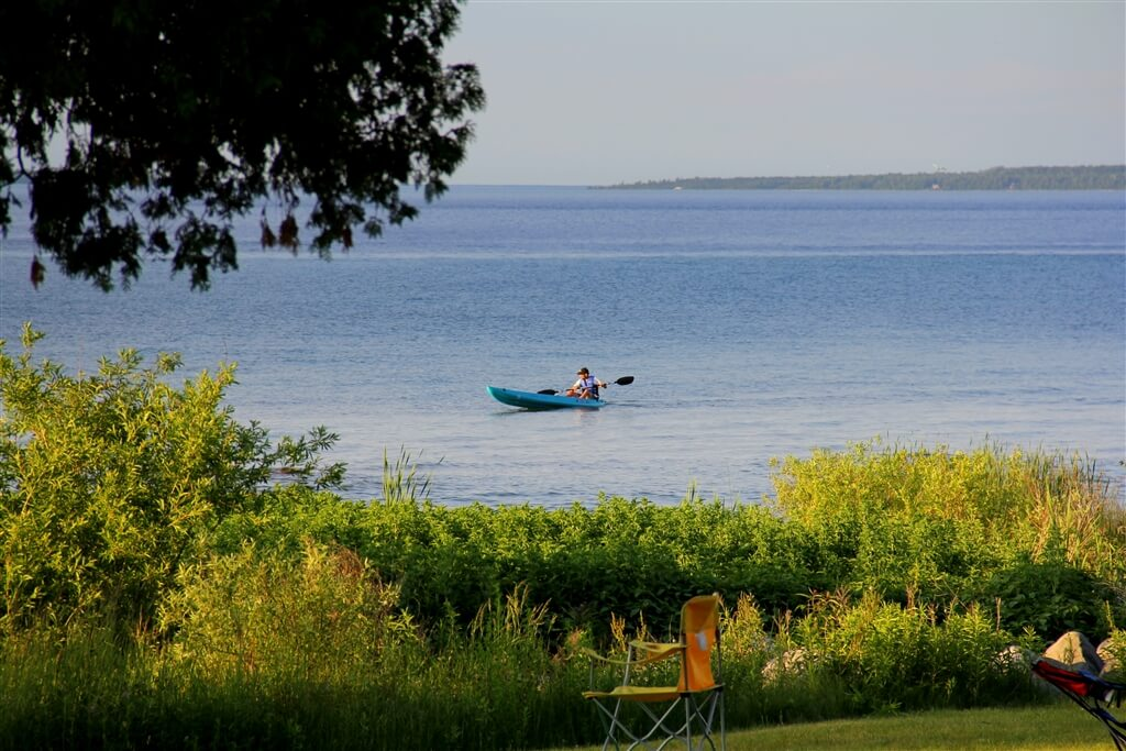 Photo of a camper kayaking at Mackinaw Mill Creek Camping in Mackinaw City, MI. © 2016 Frank Rogala.