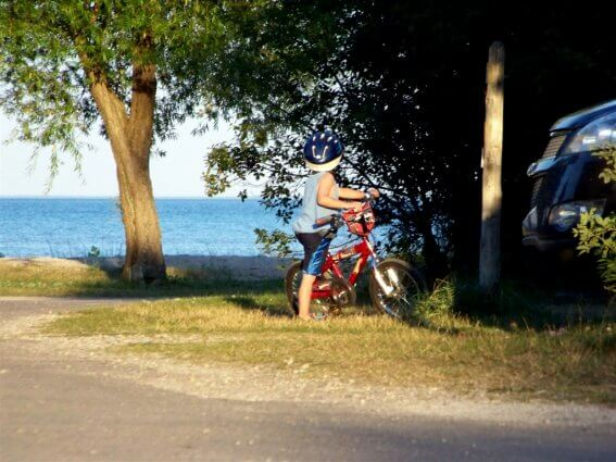 Photo of a child riding his bike at Mackinaw Mill Creek Camping in Mackinaw City, MI. © 2016 Frank Rogala.
