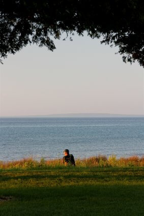 Photo of a camper finding solitude on the shores of Mackinaw Mill Creek Camping in Mackinaw City, MI. © 2016 Frank Rogala.