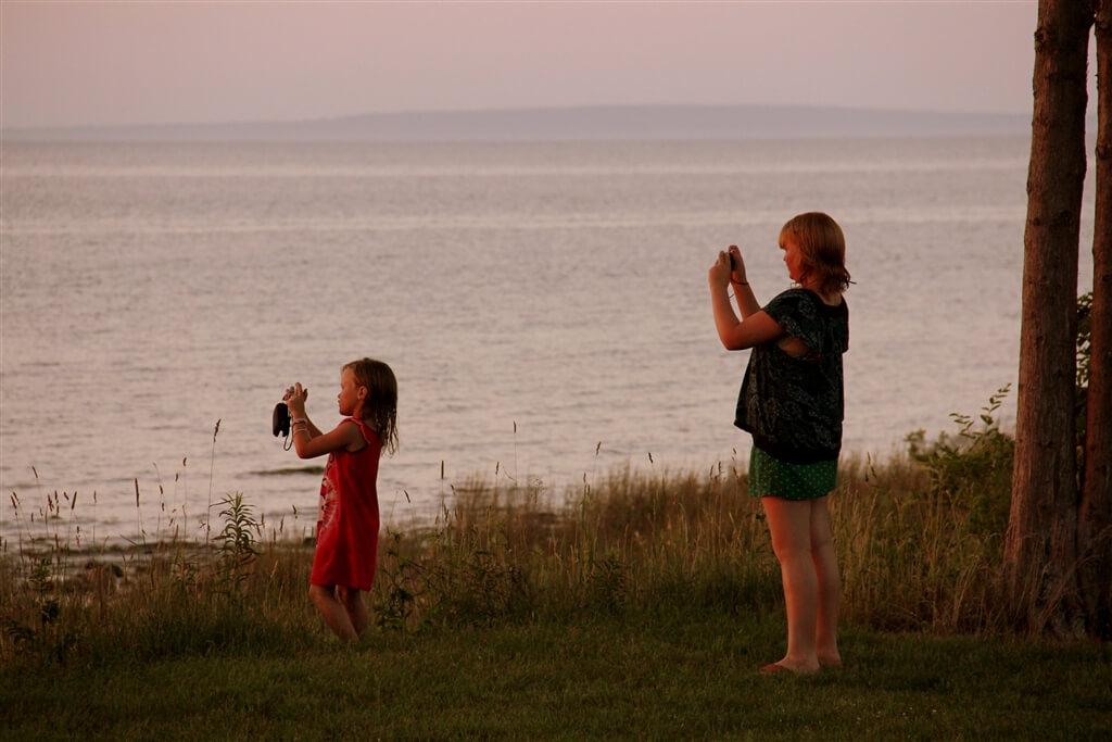 Photo of campers taking pictures of the view from Mackinaw Mill Creek Camping in Mackinaw City, MI. © 2016 Frank Rogala.
