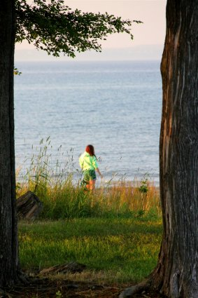 Photo of camper walking along the shores of Mackinaw Mill Creek Camping in Mackinaw City, MI. © 2016 Frank Rogala.