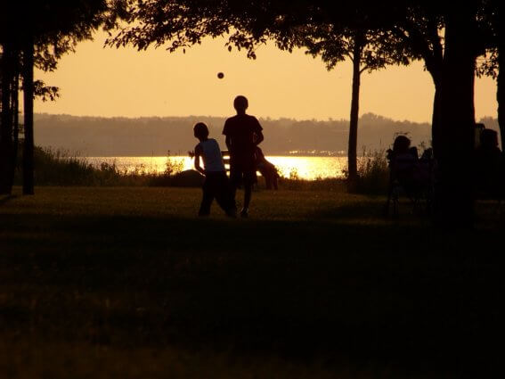 Photo of kids playing at sunset at Mackinaw Mill Creek Camping in Mackinaw City, MI. © 2016 Frank Rogala.