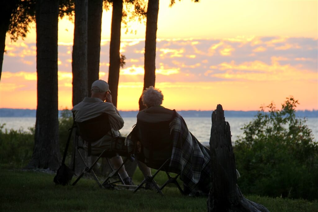 Photo of campers under a blanket viewing a sunset from Mackinaw Mill Creek Camping in Mackinaw City, MI. © 2016 Frank Rogala.