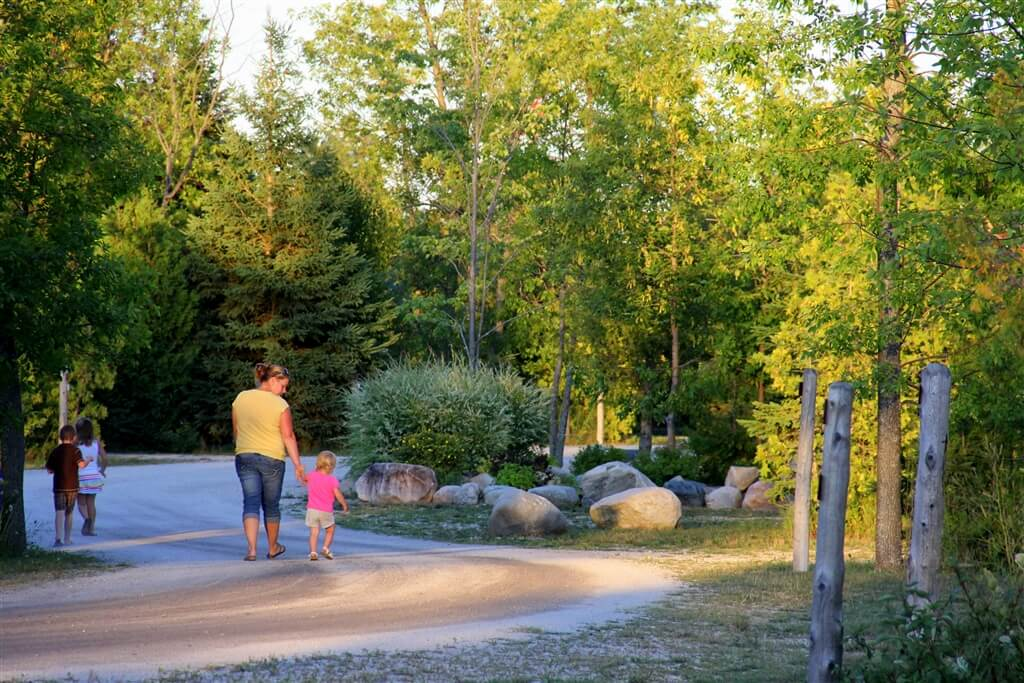 Photo of mother and child going for a walk at Mackinaw Mill Creek Camping in Mackinaw City, MI. © 2016 Frank Rogala.