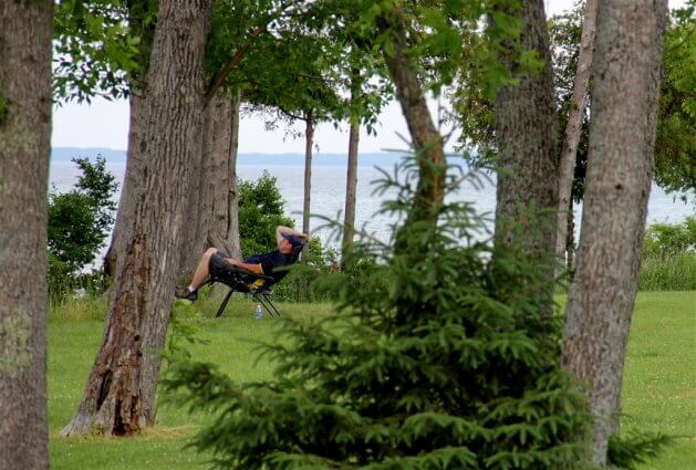 Photo of a camper in a zero gravity chair at Mackinaw Mill Creek Camping in Mackinaw City, MI. © 2016 Frank Rogala.