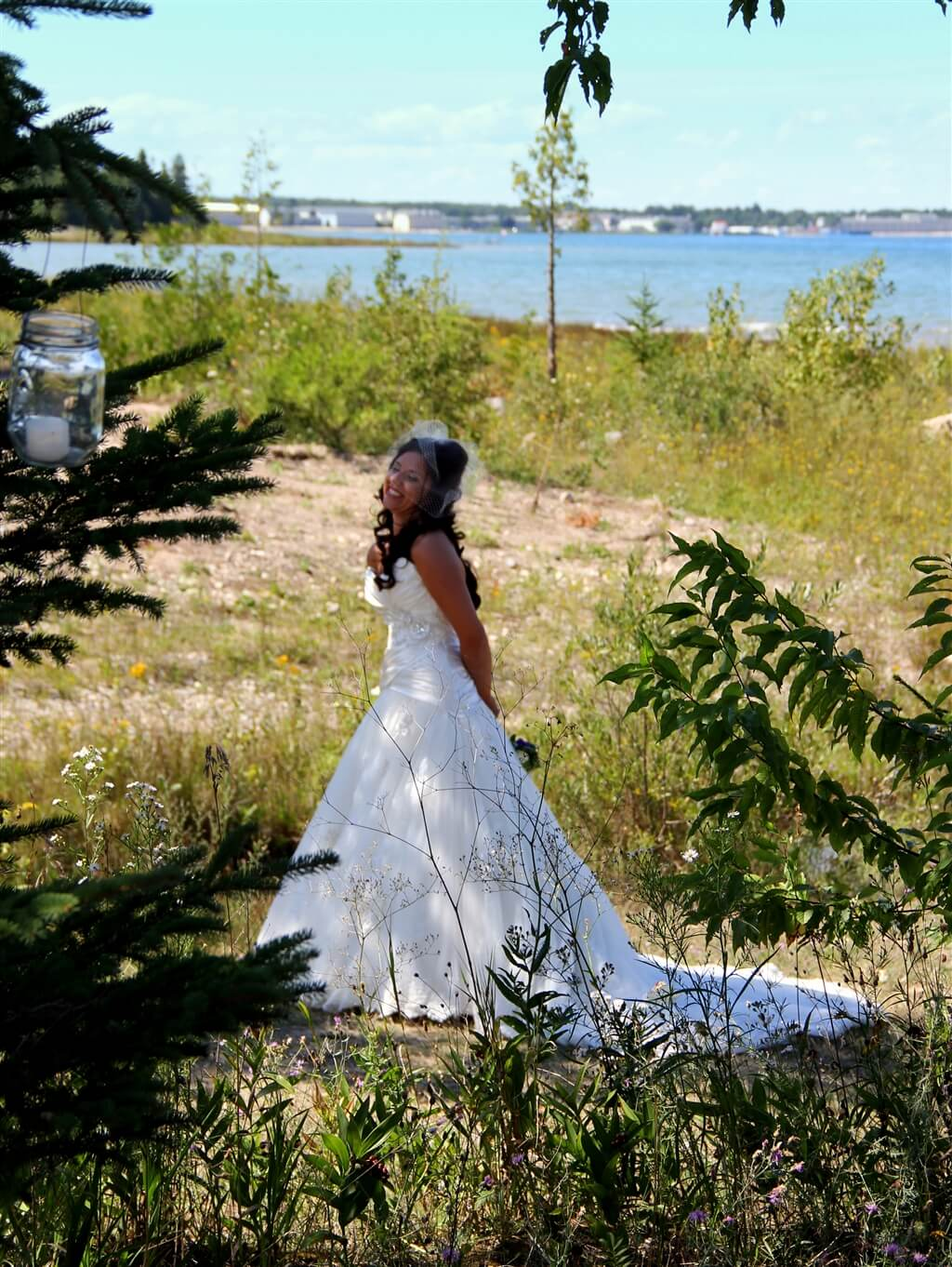 Photo of the bride of a wedding on the Straits of Mackinac at Mackinaw Mill Creek Camping in Mackinaw City, MI. © 2016 Frank Rogala.